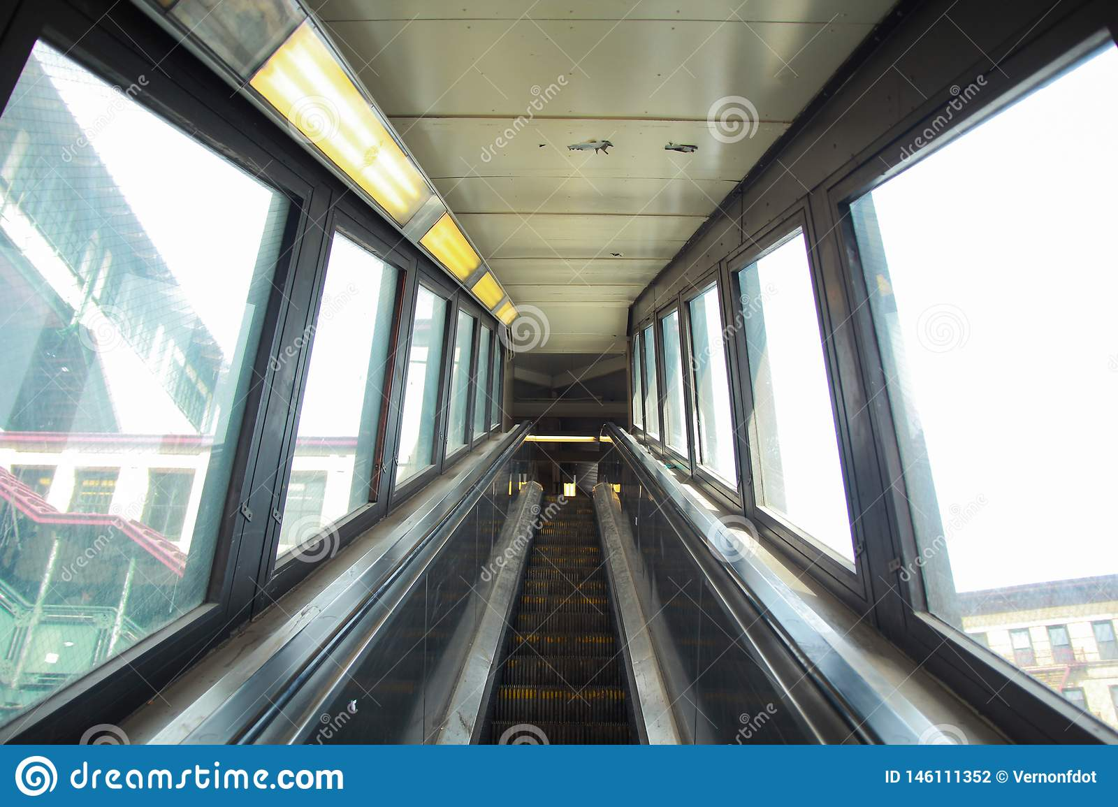 Escalator going up to train station in new york city