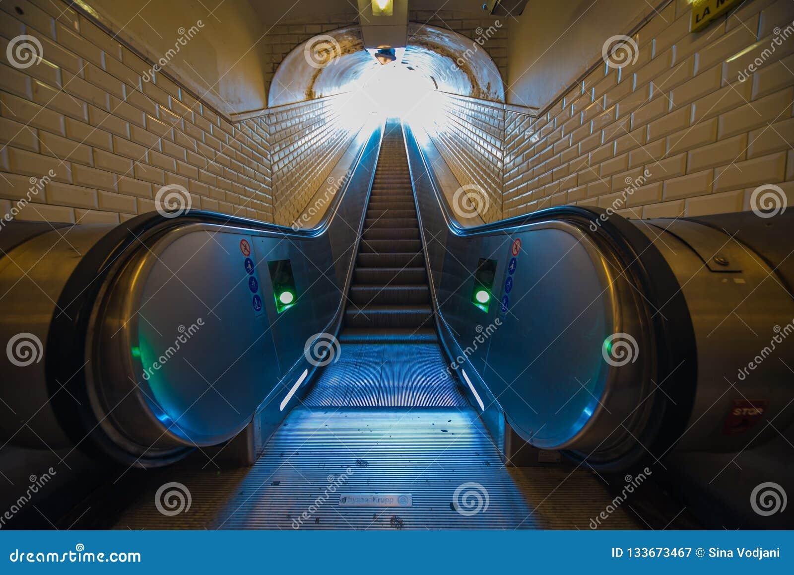 Escalator perspective to the exit tunnel Metro Paris