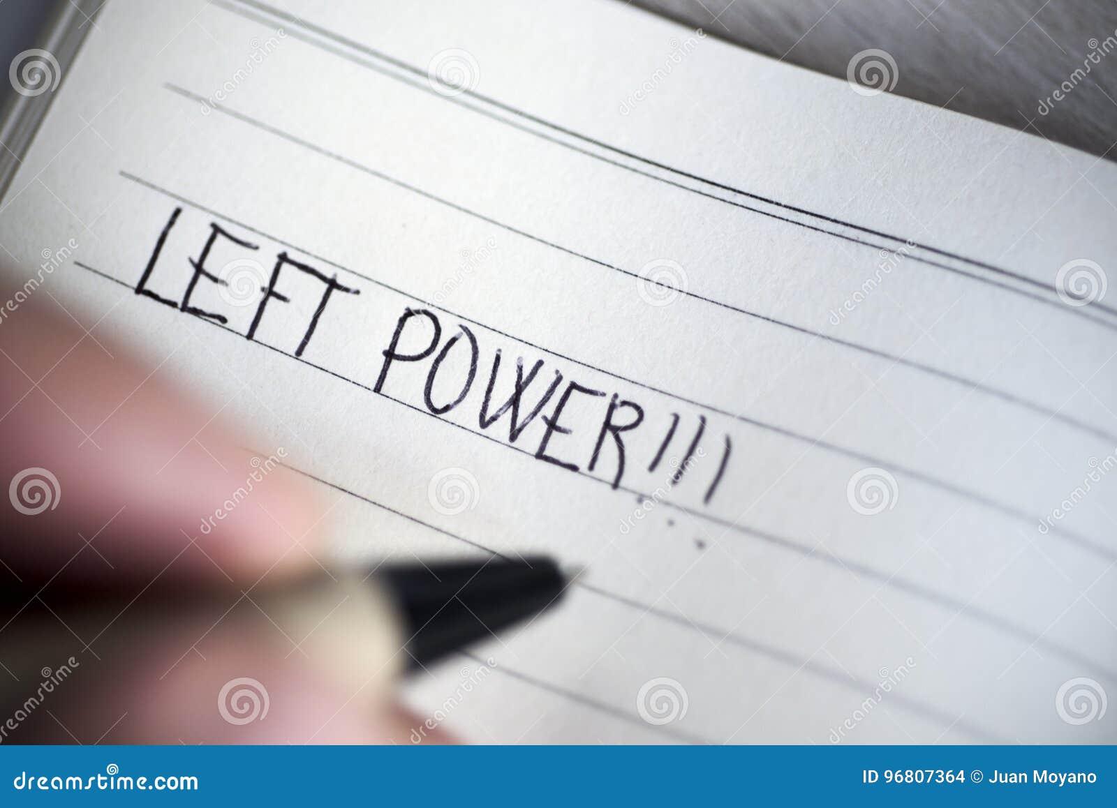 Escrita canhota do homem o poder esquerdo do texto