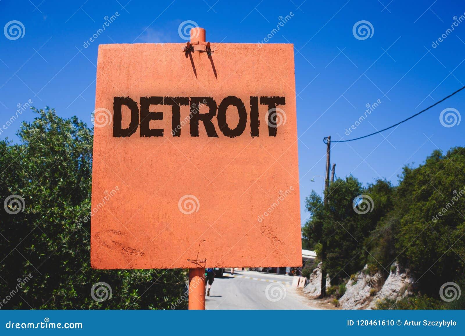 Escrita conceptual da mão que mostra Detroit Cidade do texto da foto do negócio na capital do Estados Unidos da América de Michig