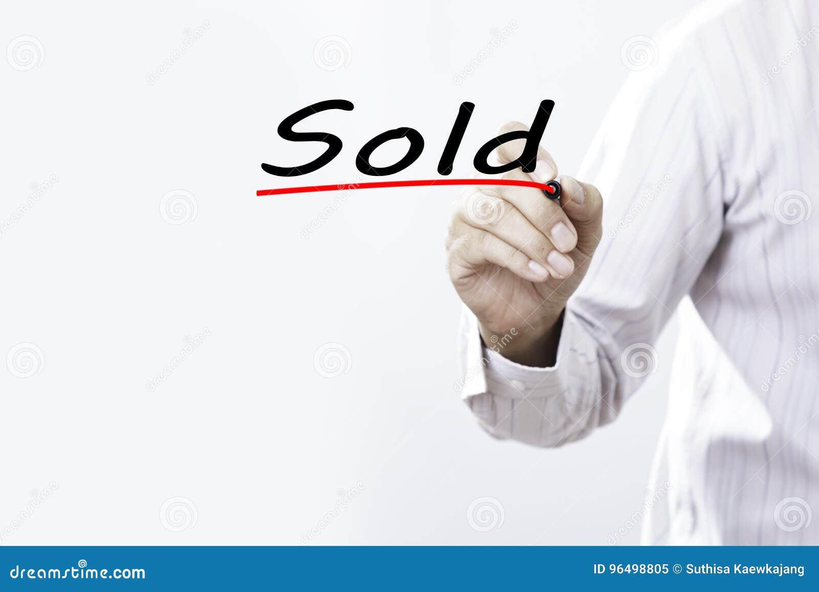 Escritura vendida, concepto de la mano del hombre de negocios del negocio