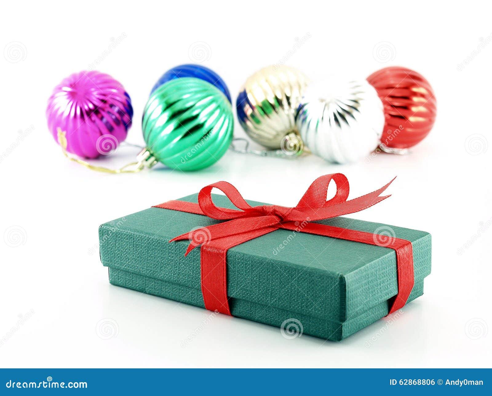 Esferas da caixa e do Natal de presente