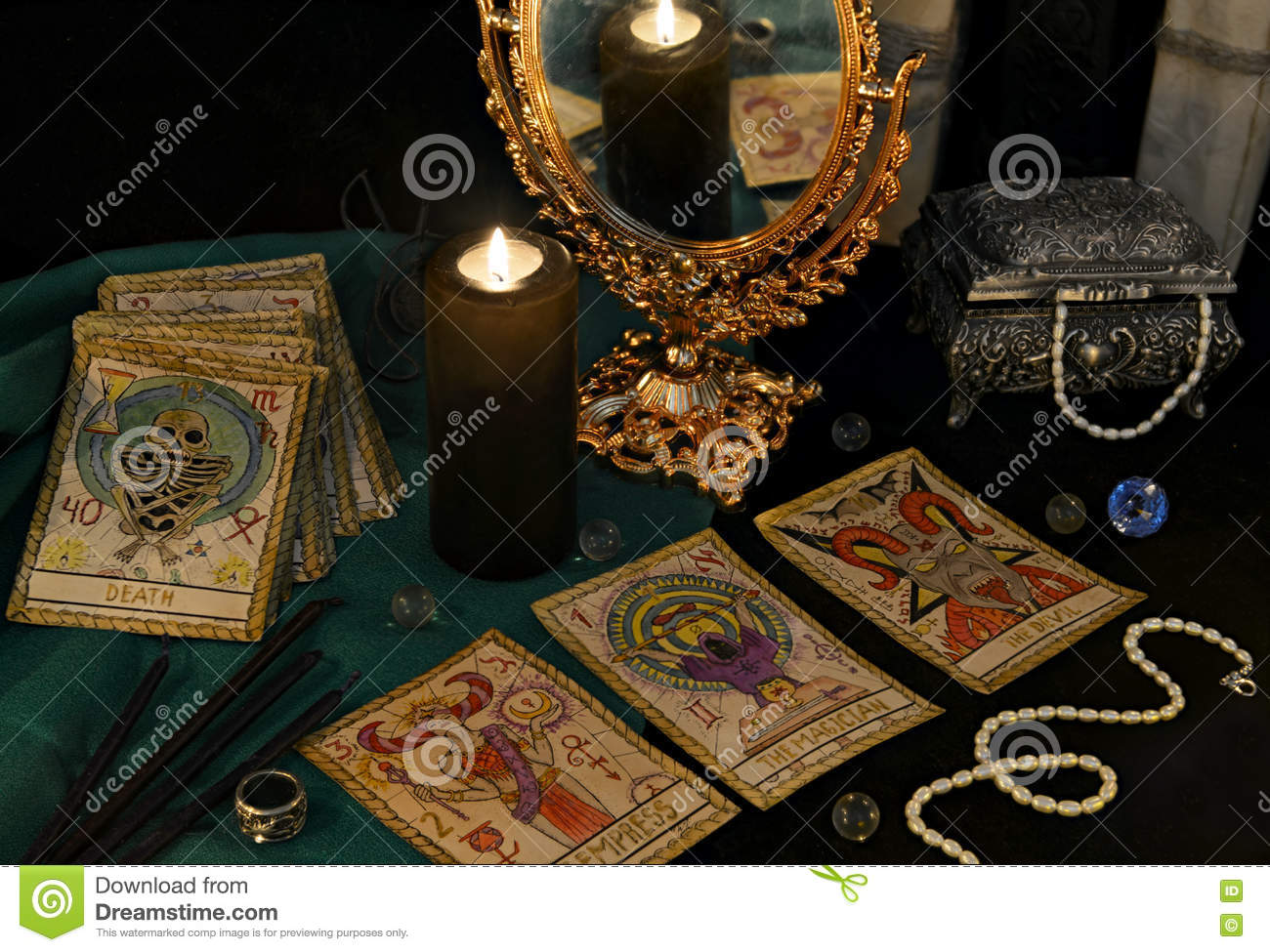 Esoteric still life with the Tarrot cards, mirrow and crystals