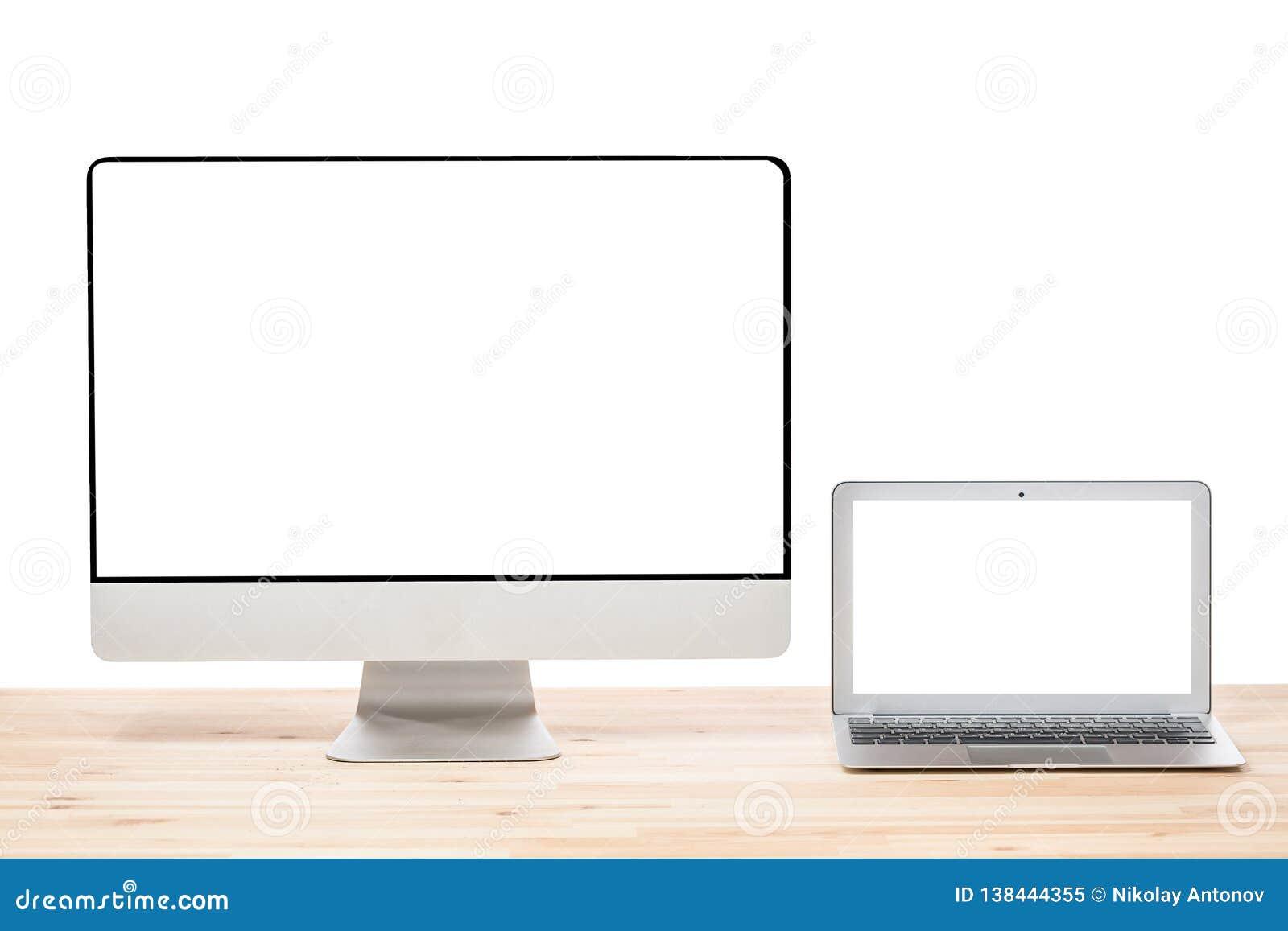 Espaço de trabalho conceptual ou conceito do negócio Laptop e exposição grande do monitor do computador com as telas brancas vazi