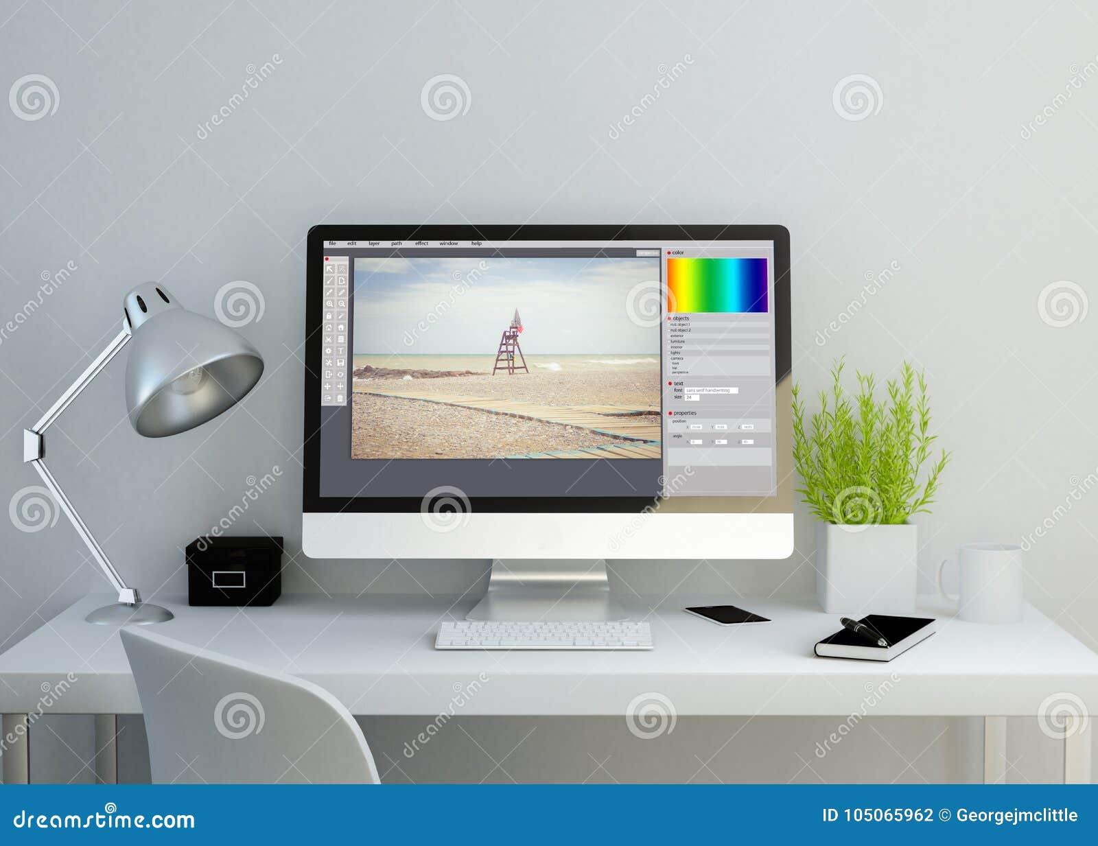 Espace de travail propre moderne avec le photographe éditeur sur l écran
