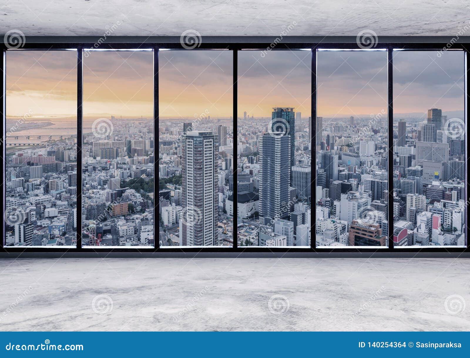 Espacio interior moderno vacío con la opinión de la ciudad del rascacielos en la puesta del sol, interior vacío de la oficina de