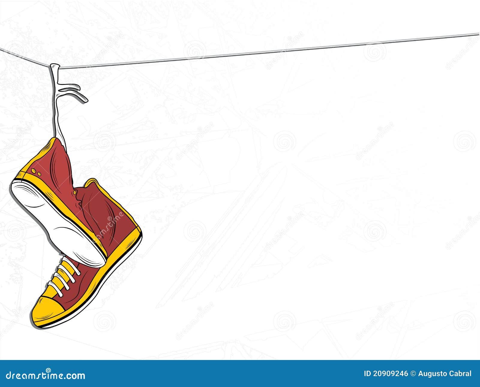 Espadrilles s arrêtant sur le fil sur le fond blanc