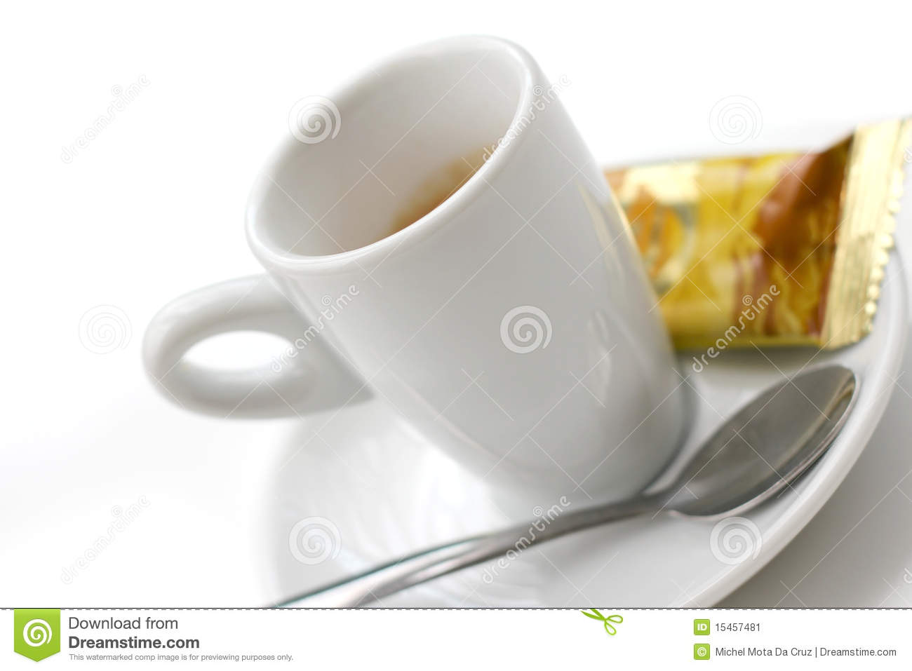 Cup of espresso coffee on saucer with wrapped biscuit or cookie ...