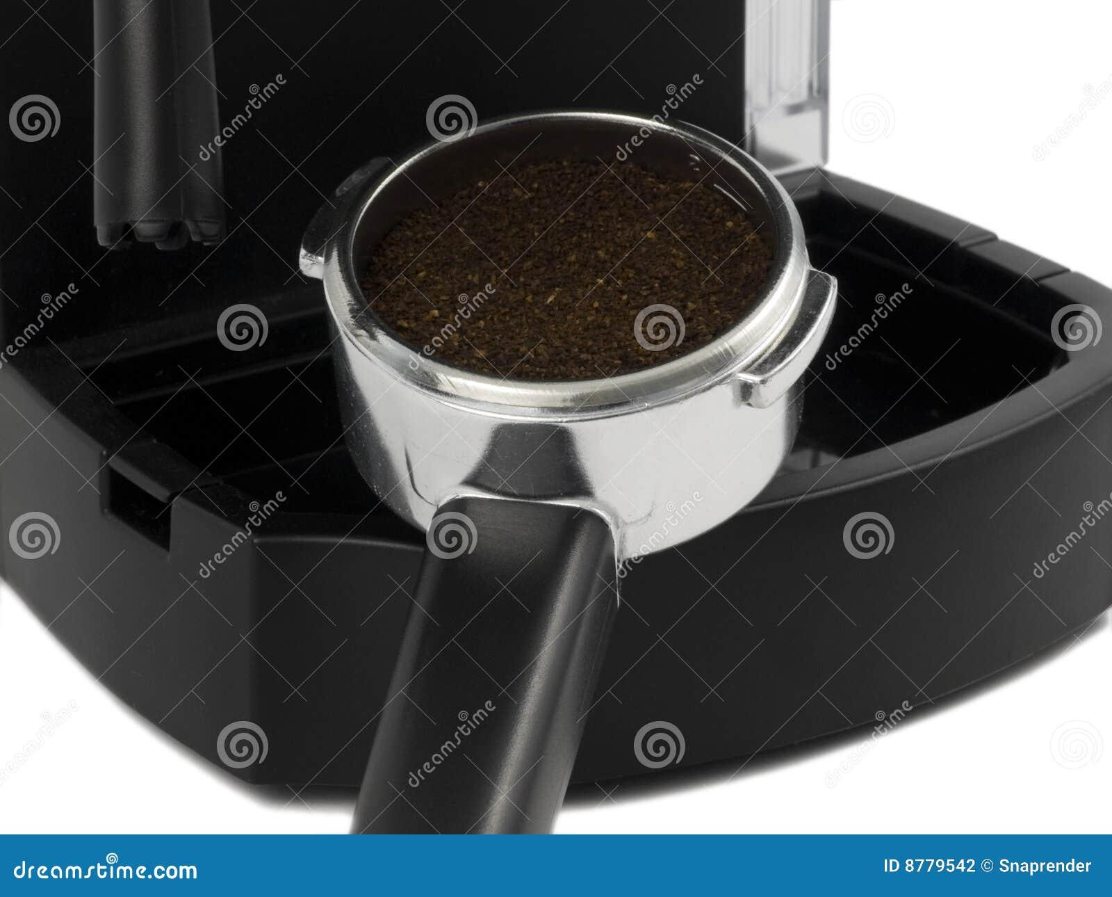 Espresso Filter Holder ~ Espresso grounds in filter holder stock photography