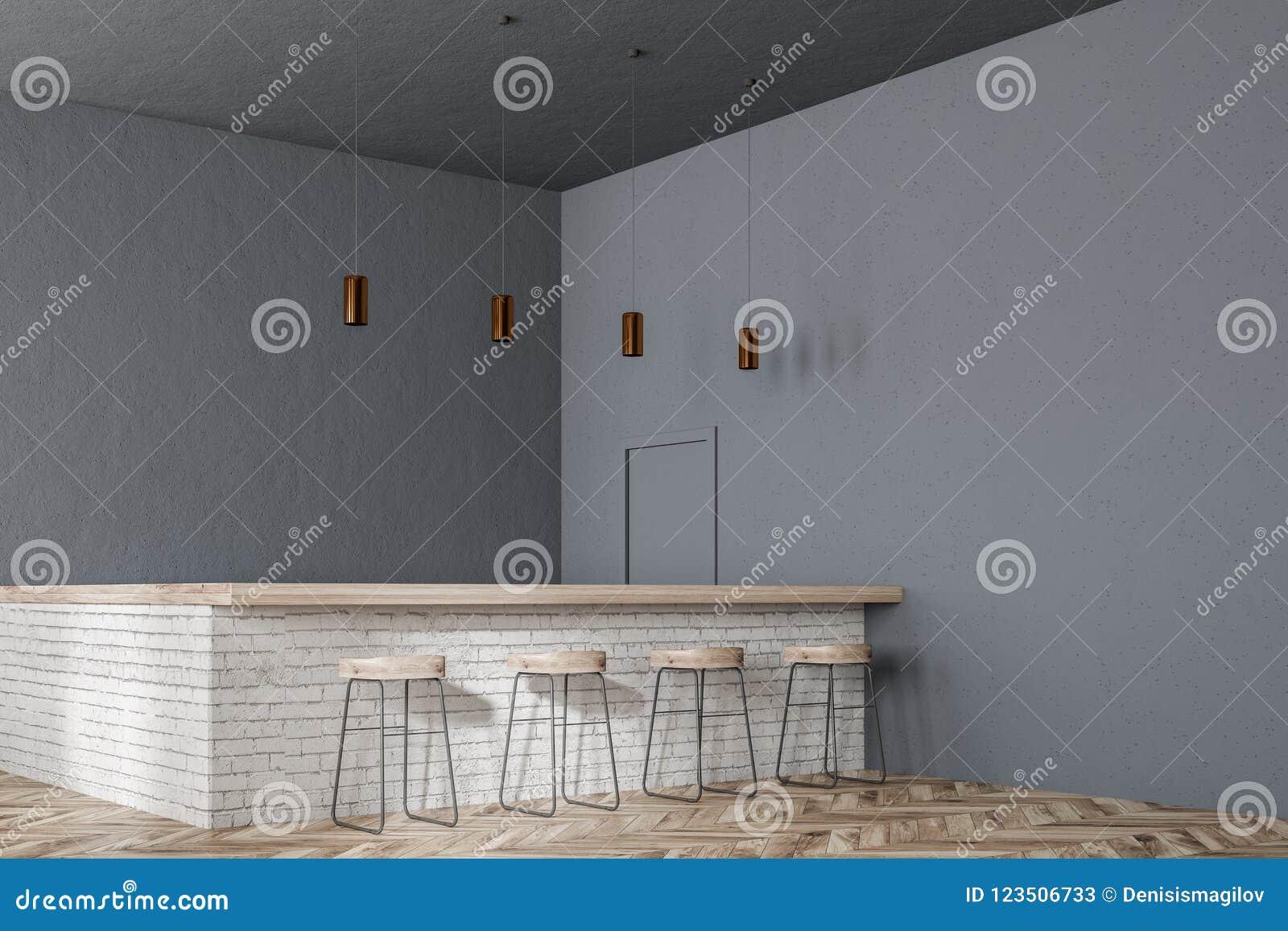 d8ac4b347851 Barra con los taburetes en una esquina moderna del restaurante con paredes  grises, un piso de madera y una fila de las lámparas del techo mofa de la  ...