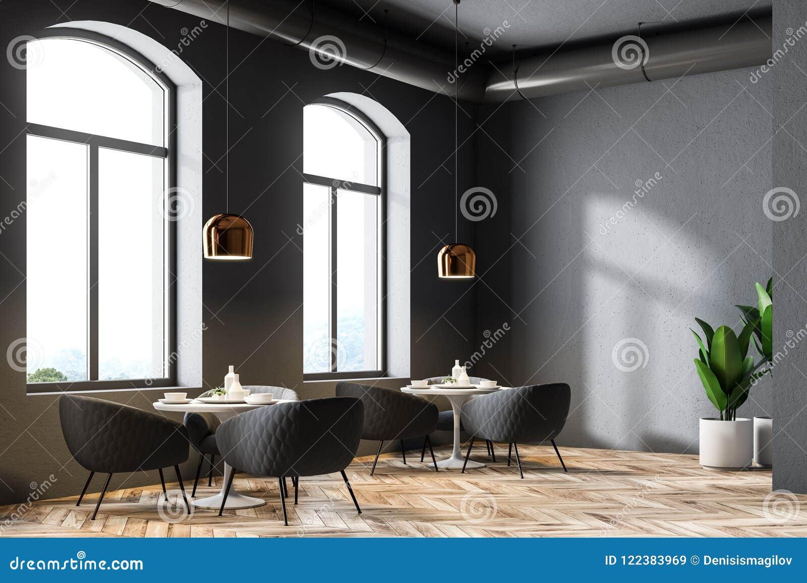 68d9604c3dd2 Esquina moderna del restaurante con las paredes grises, las ventanas  grandes, un piso de madera y las mesas redondas con las butacas mofa de la  ...