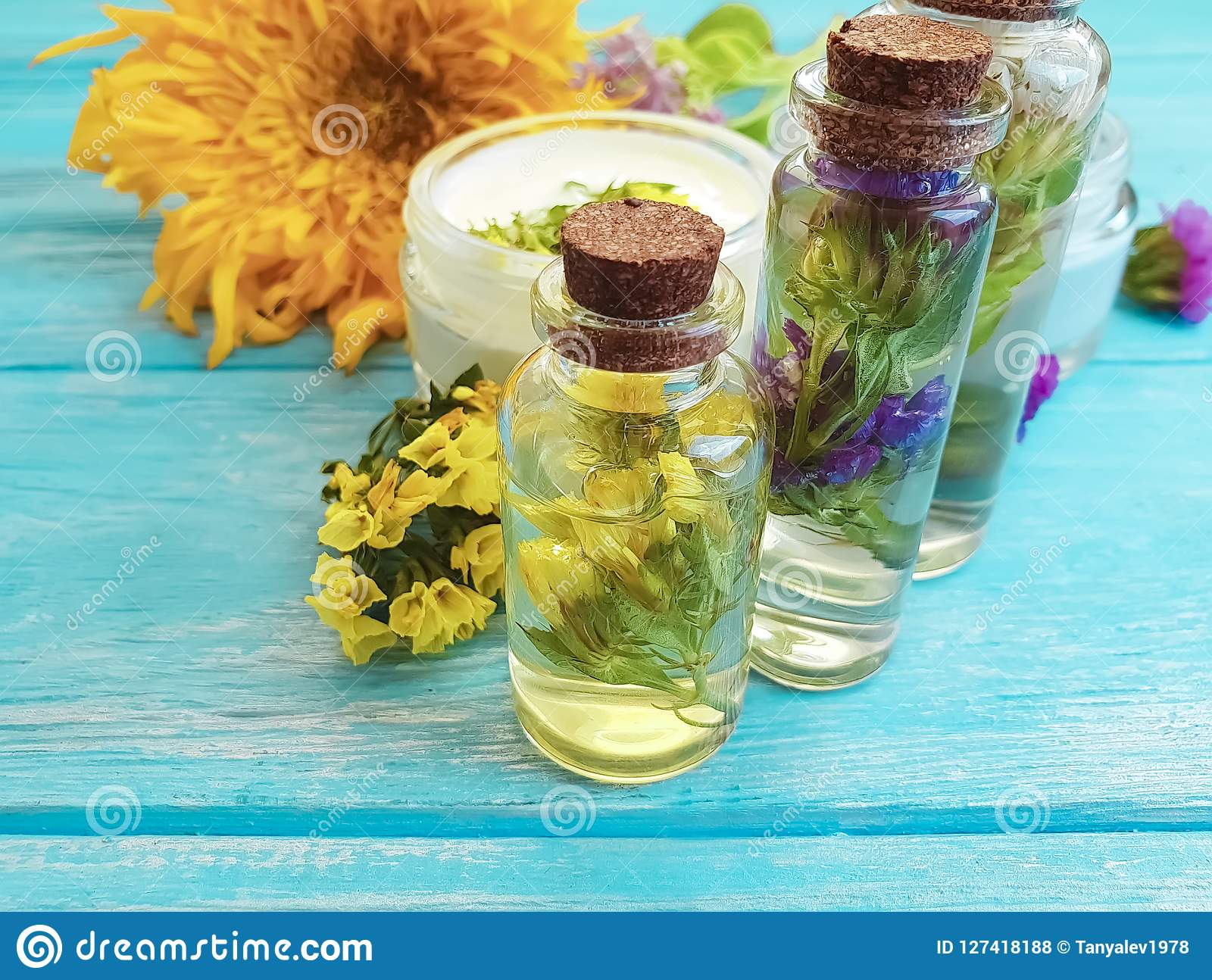 essence, cream cosmetic vintage scented aromatic relax alternative wellness natural flowers on a wooden