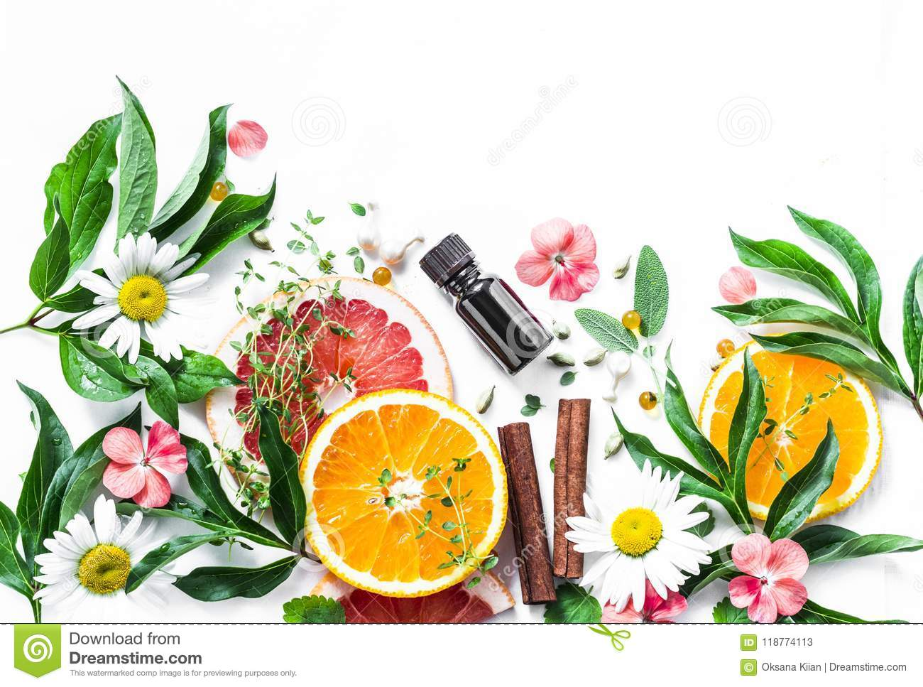 Essential oil for beauty skin. Flat lay beauty ingredients on a light background, top view. Beauty healthy lifestyle concept