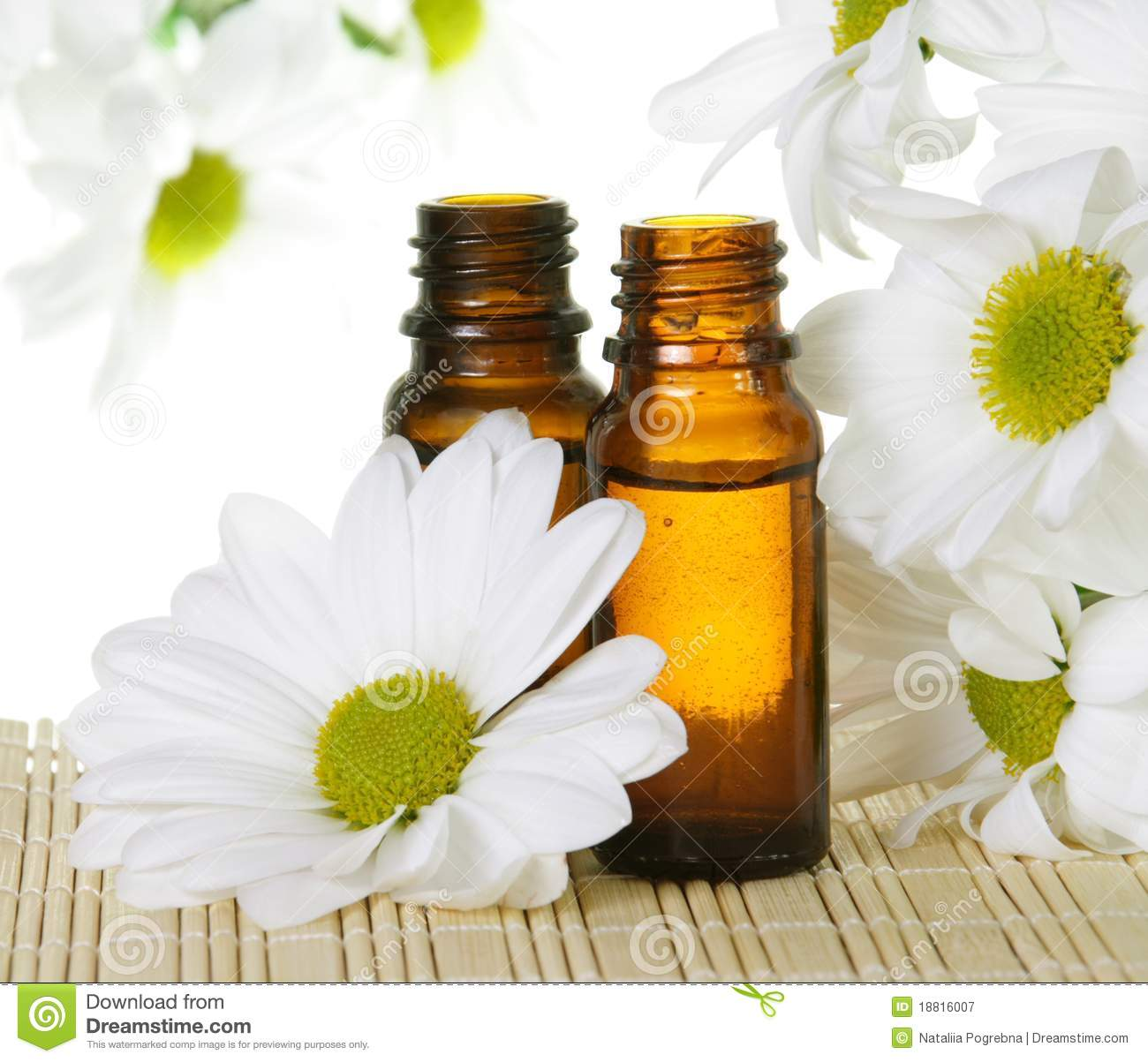 Essential Oil Bottles With White Daisy Royalty Free Stock
