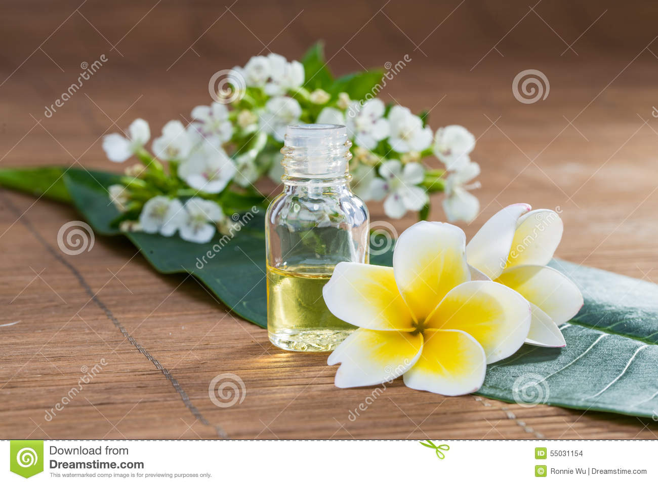 Essential Oil, flower, on green leaf, blur background, health sp