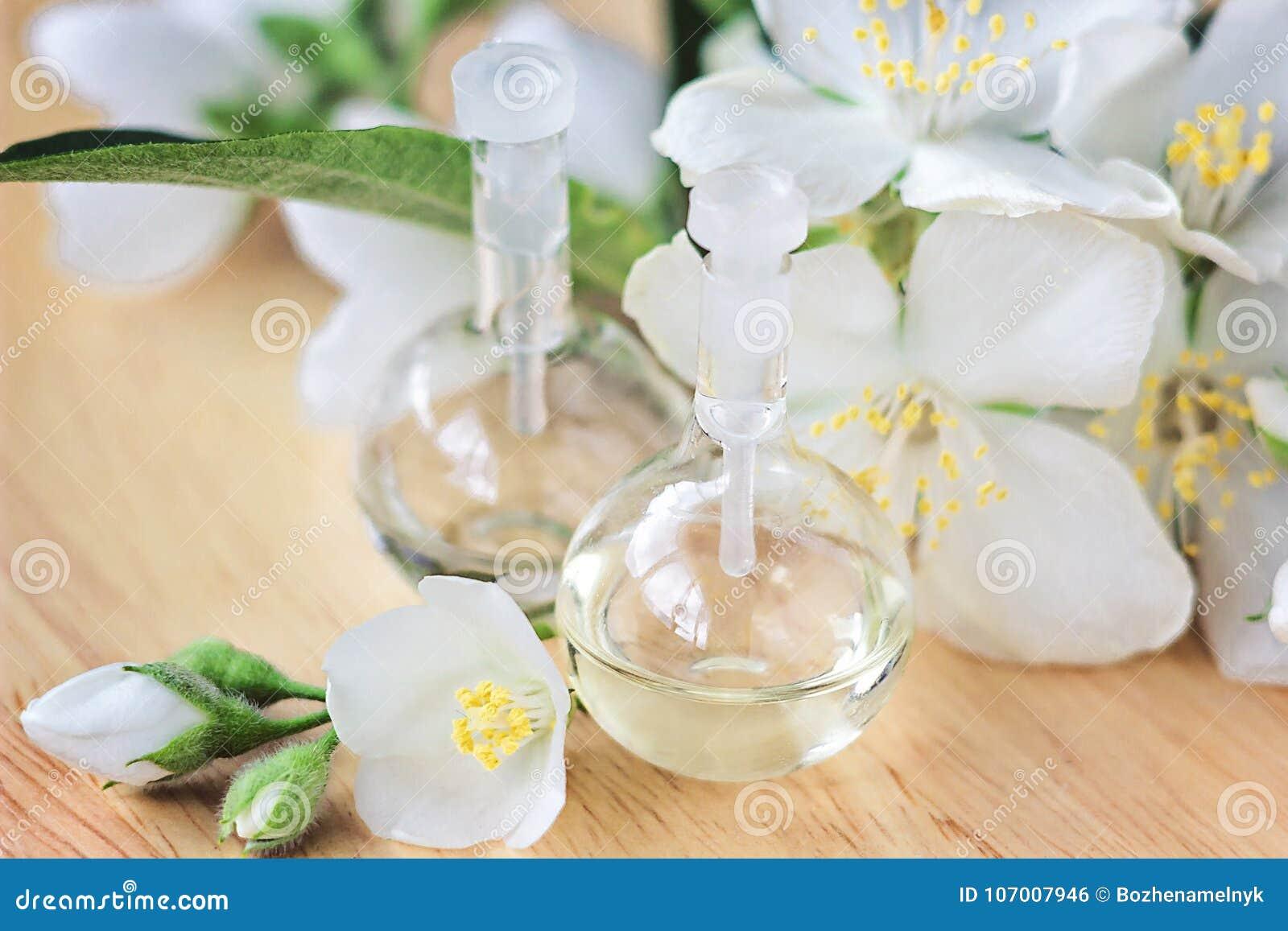 Essential oil in glass bottle with fresh jasmine flowers beauty royalty free stock photo izmirmasajfo