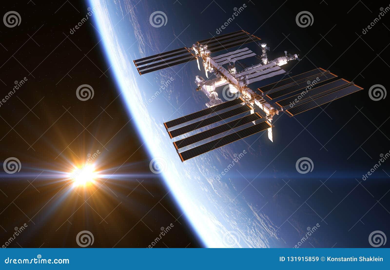Estación espacial internacional en el fondo del sol naciente