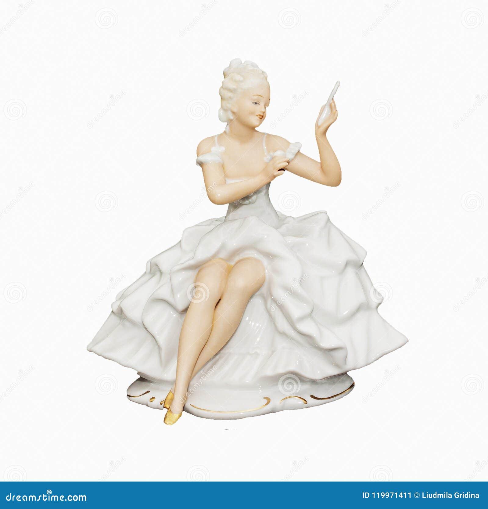 Estatueta da porcelana de uma menina mim