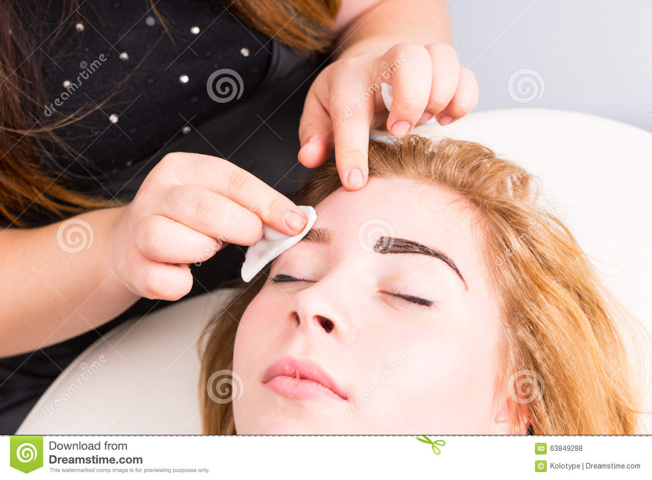 Esthetician Tidying Eyebrows Of Female Client Stock Photo - Image of ...
