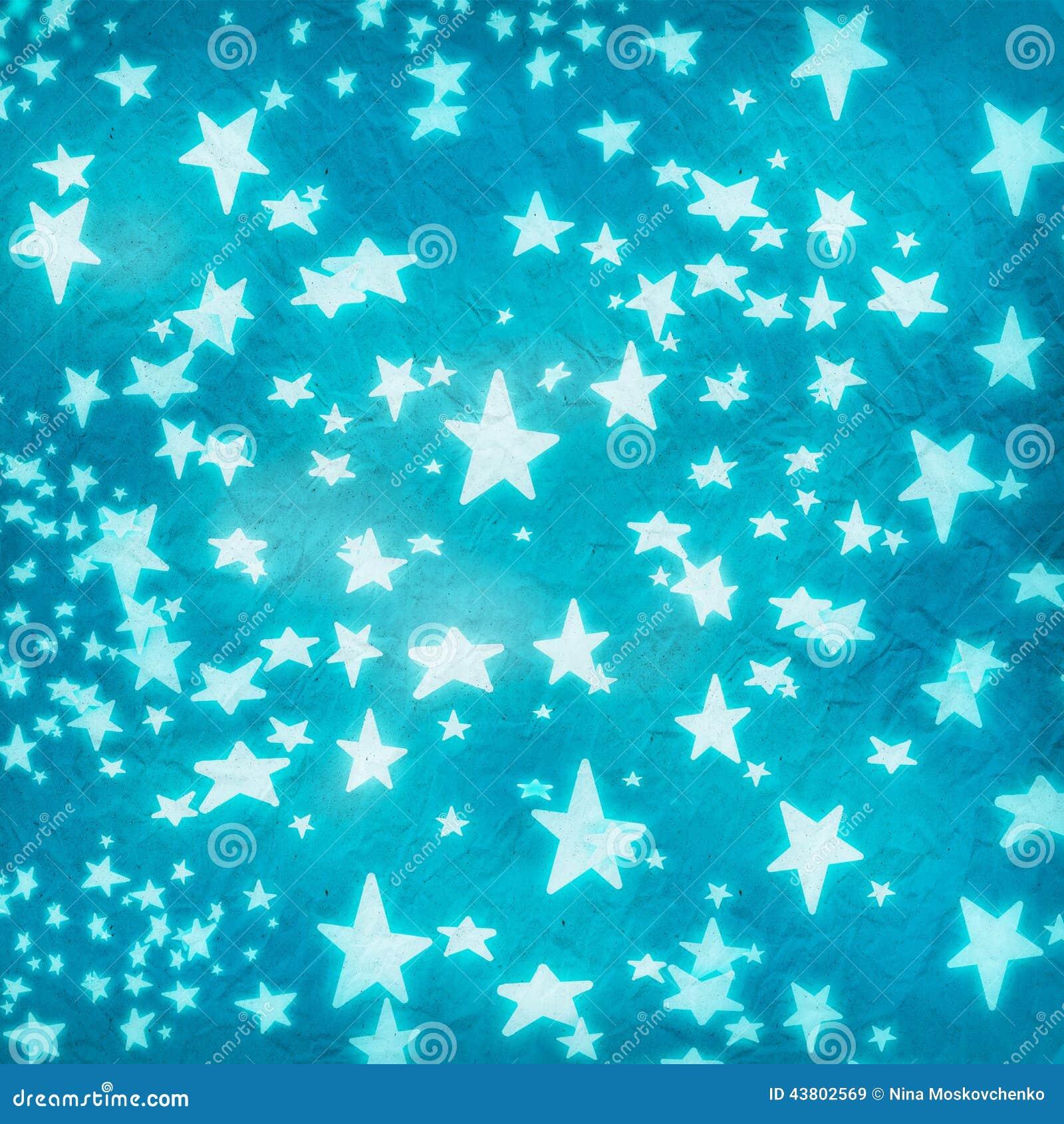 Estrelas no papel amarrotado azul