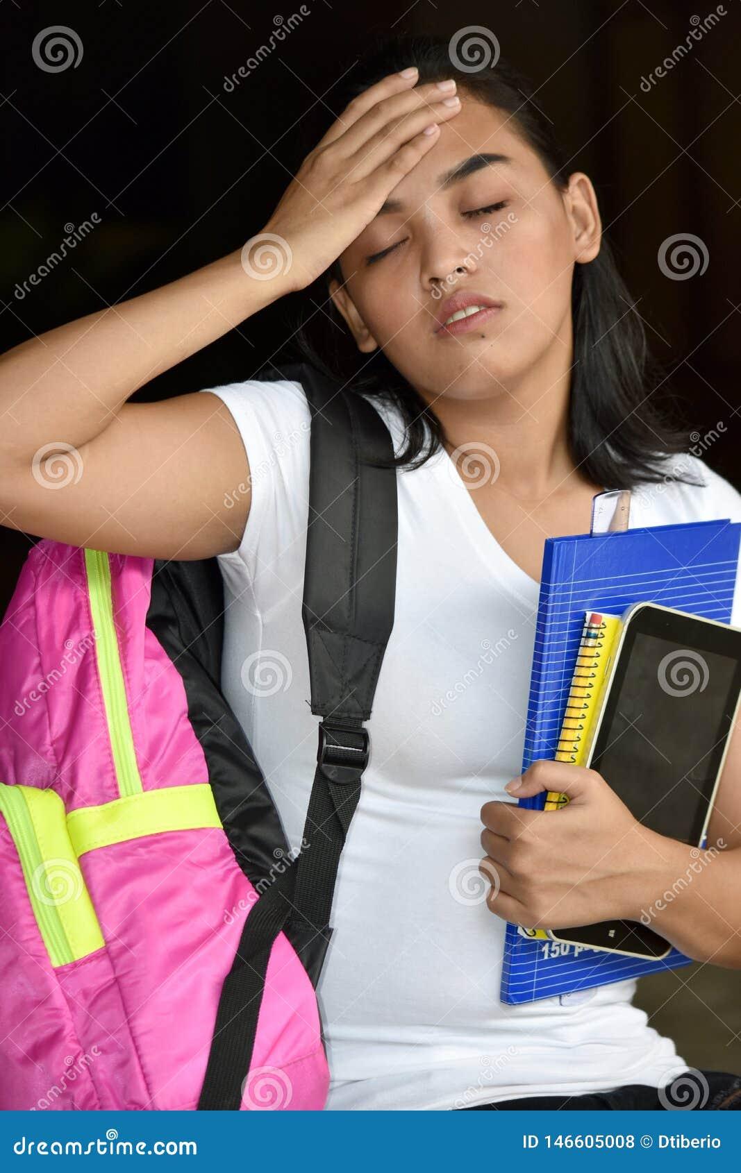 Estudante fêmea With Headache