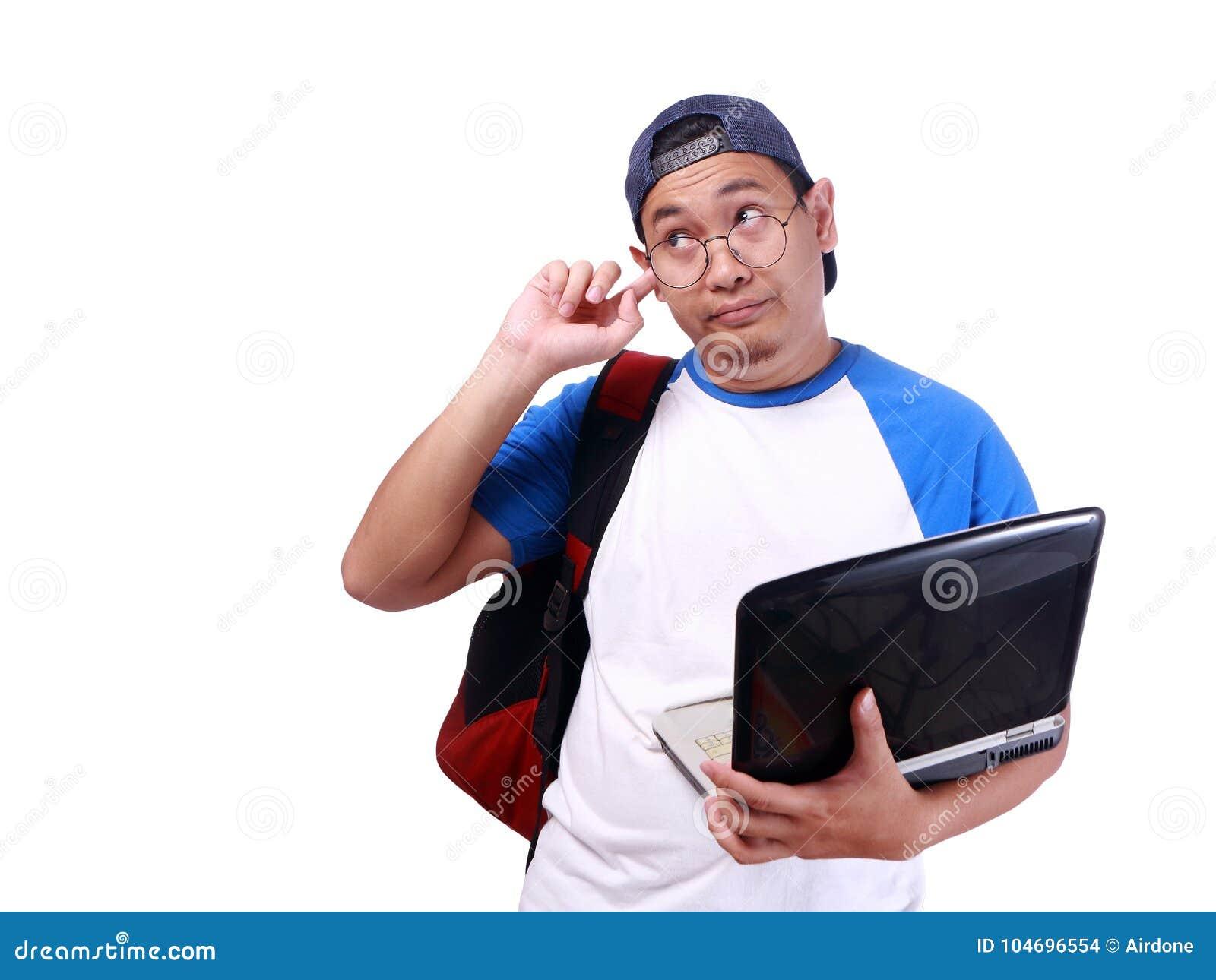 Estudiante asiático joven Covering His Ear que ignora alguien