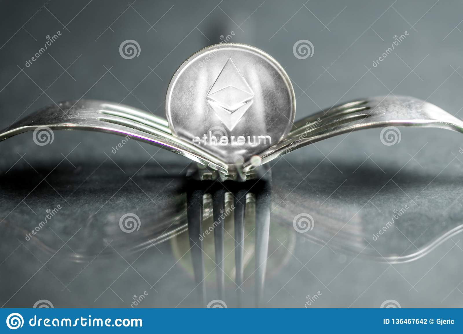 Ethereum Cryptocurreny Coin Placed Between Forks With Reflection