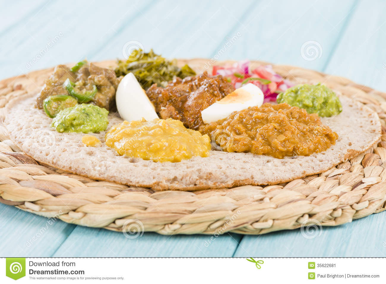 Ethiopian Feast - Injera (sourdough flatbread) with doro wat (red ...