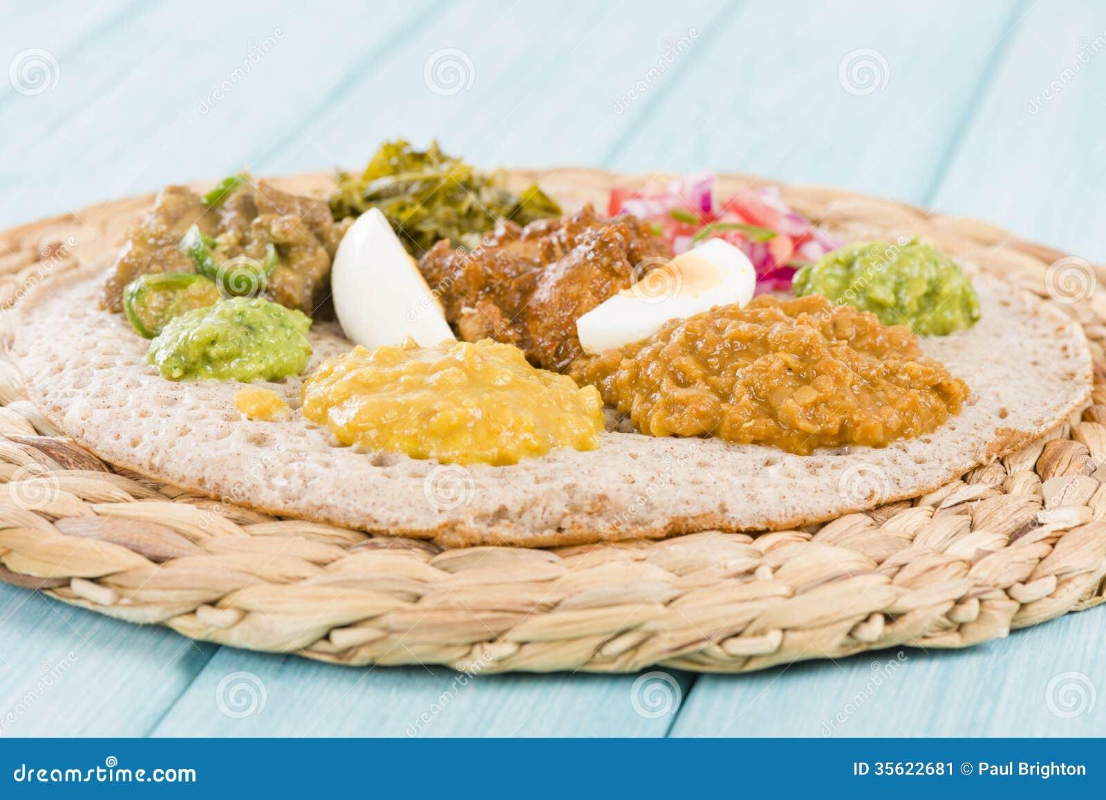 Ethiopian Feast - Injera (sourdough flatbread) with doro wat (red ...