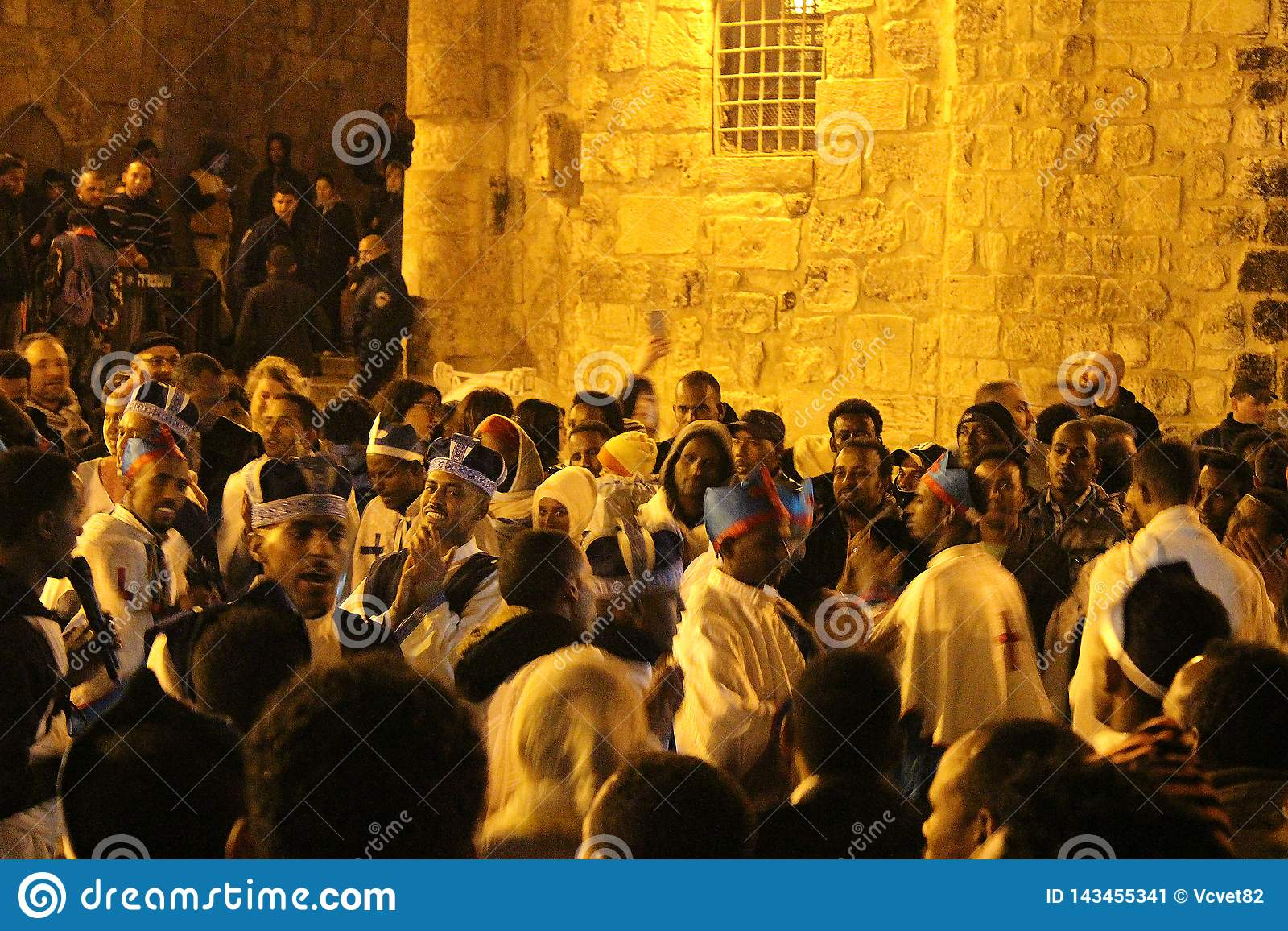 Ethiopian priests and monks singing and praying in Atrium in The Church of the Holy Sepulchre