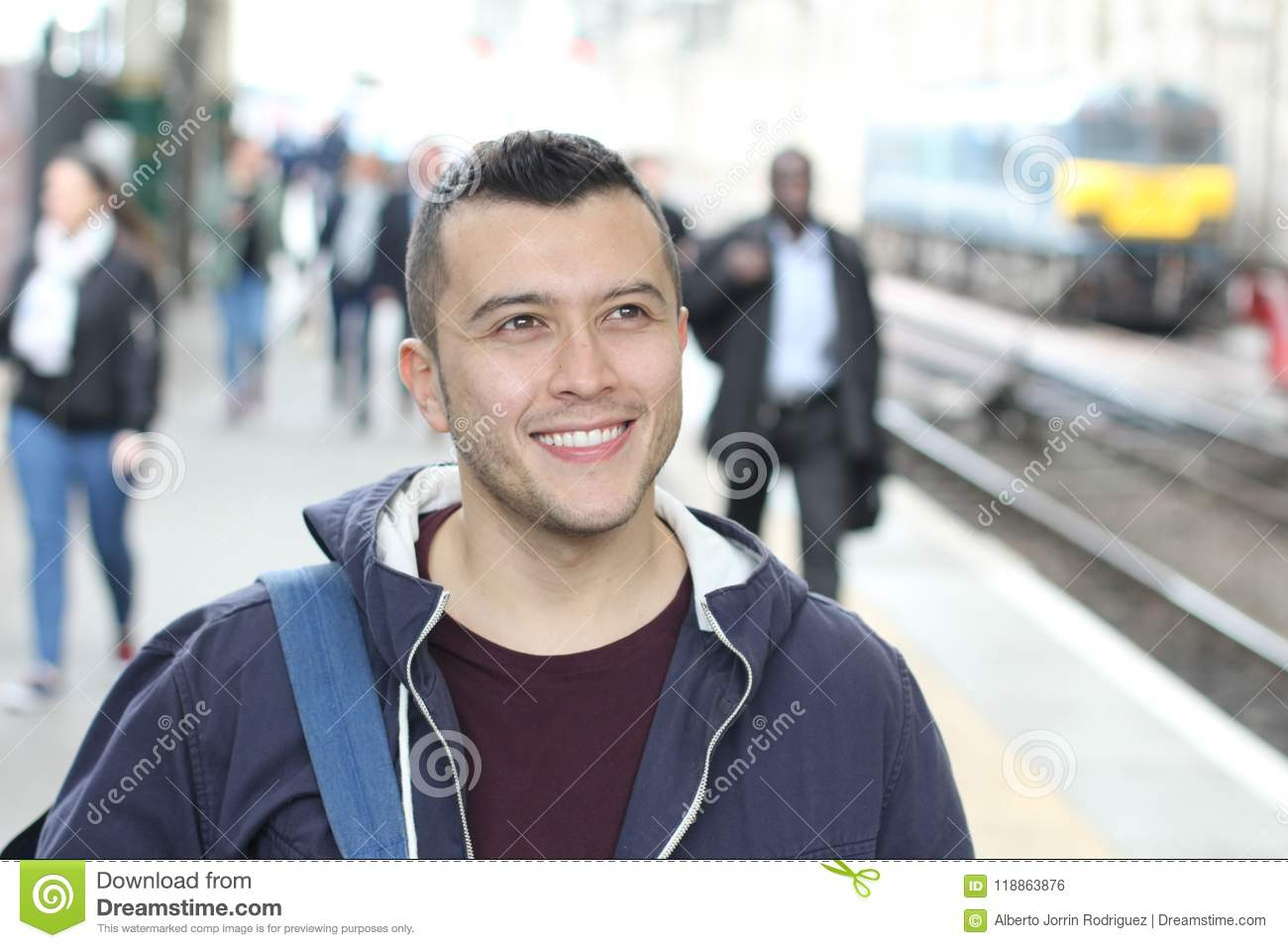 Ethnic commuter smiling in the crowd