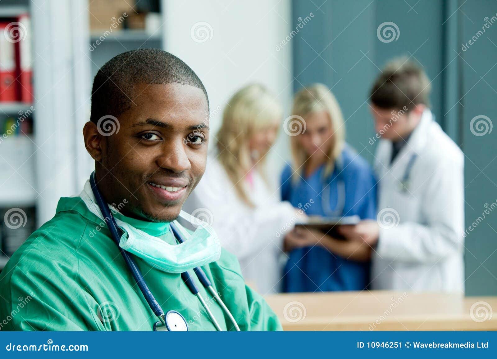Ethnic hospital smiling surgeon