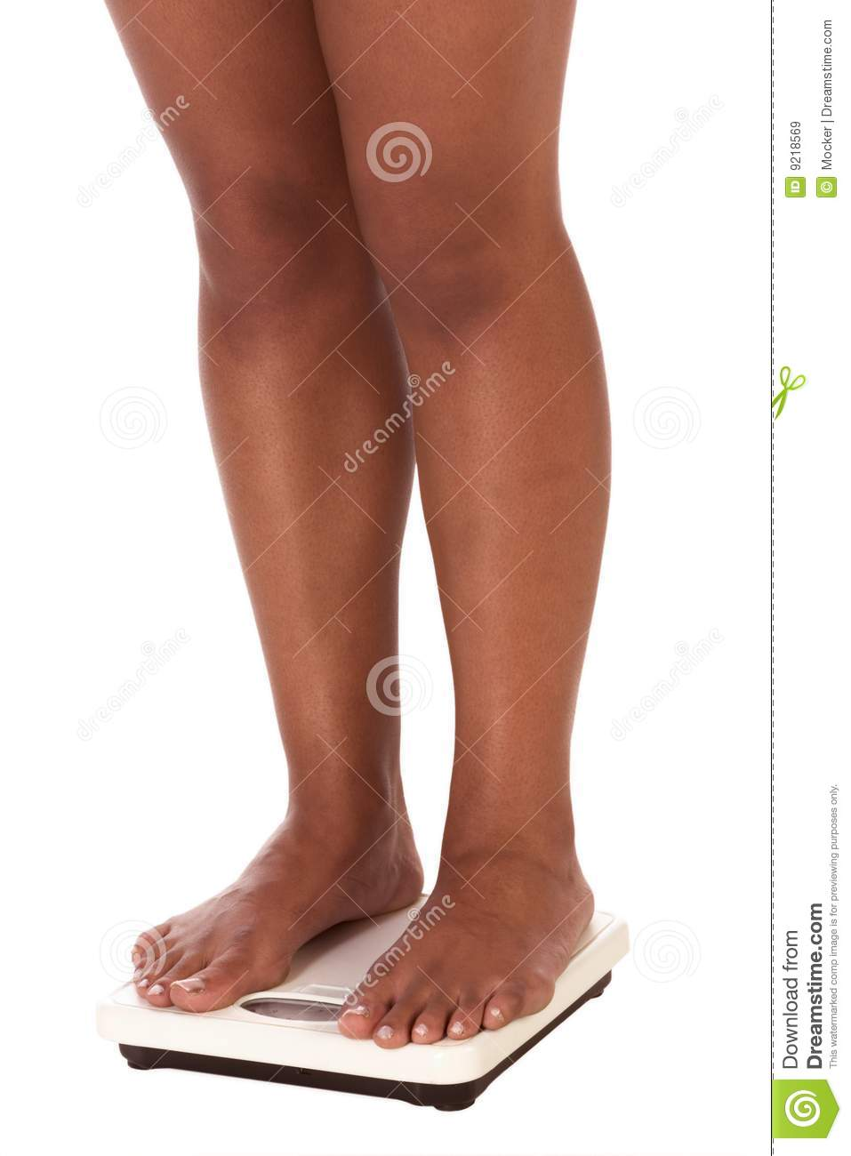 Old Woman Standing On A Bathroom Scales Stock Photo