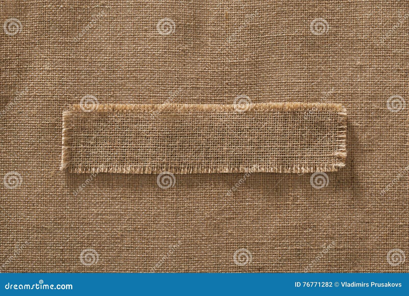 Etiqueta da parte do quadro da tela de serapilheira sobre a juta de linho de pano de saco