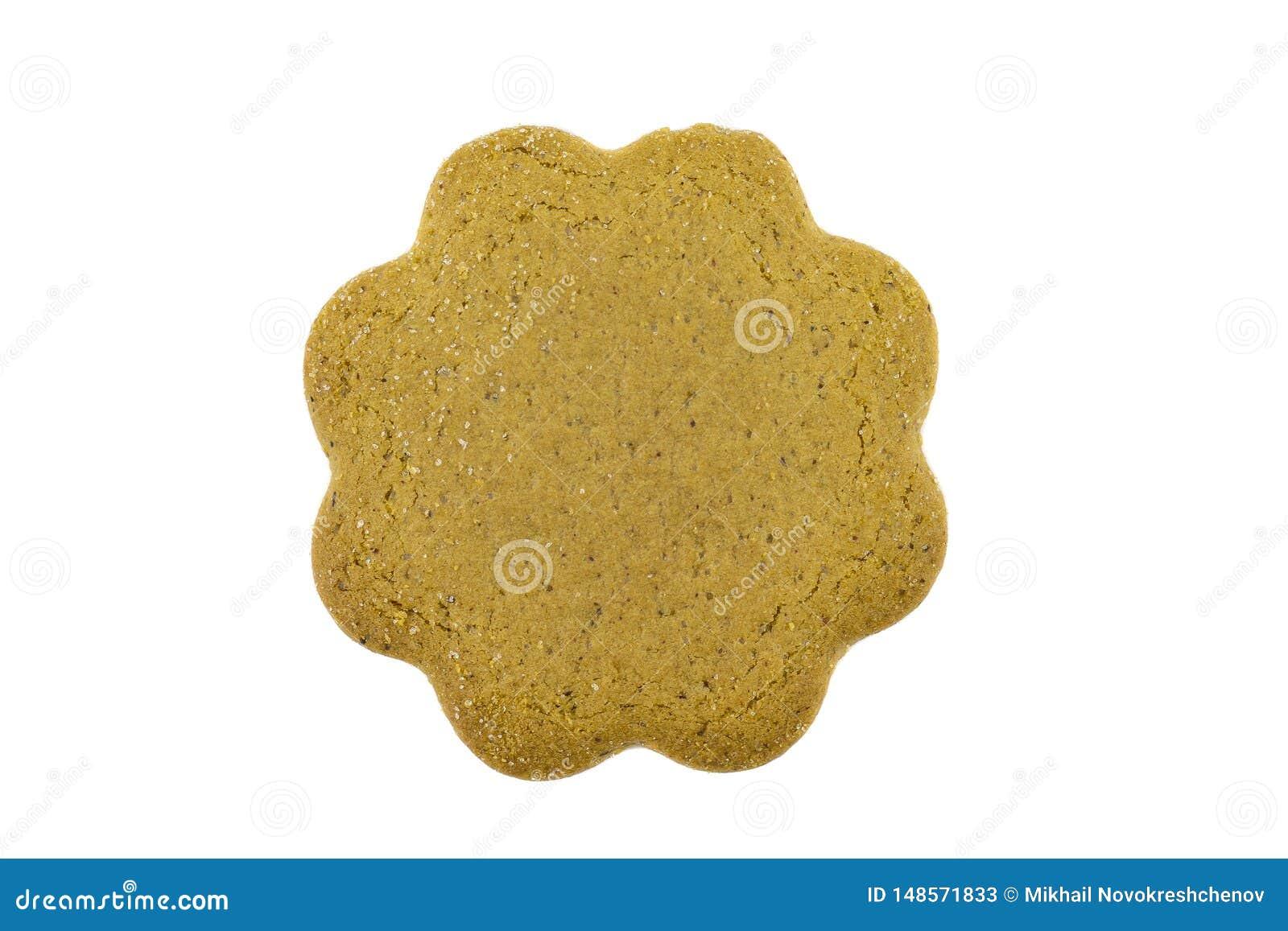 Ett över huvudet foto av en enkel ljust rödbrun kaka som isoleras på vit bakgrund