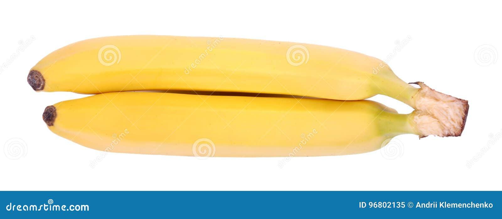 Ett slut upp av ett par av gula bananer Söta bananer som isoleras på en vit bakgrund Tropiska frukter mycket av healthful vitamin