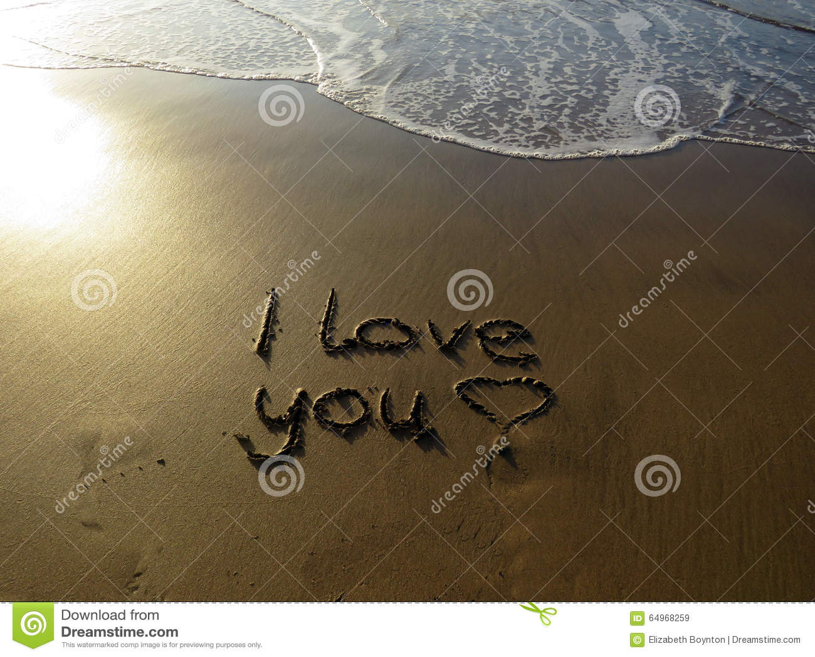 Eu Te Amo Escrito Na Areia Imagem De Stock. Imagem De