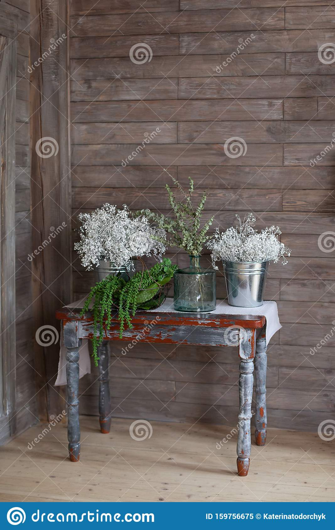 Eucalyptus Sprigs With Fresh Leaves In Vases On A Wooden