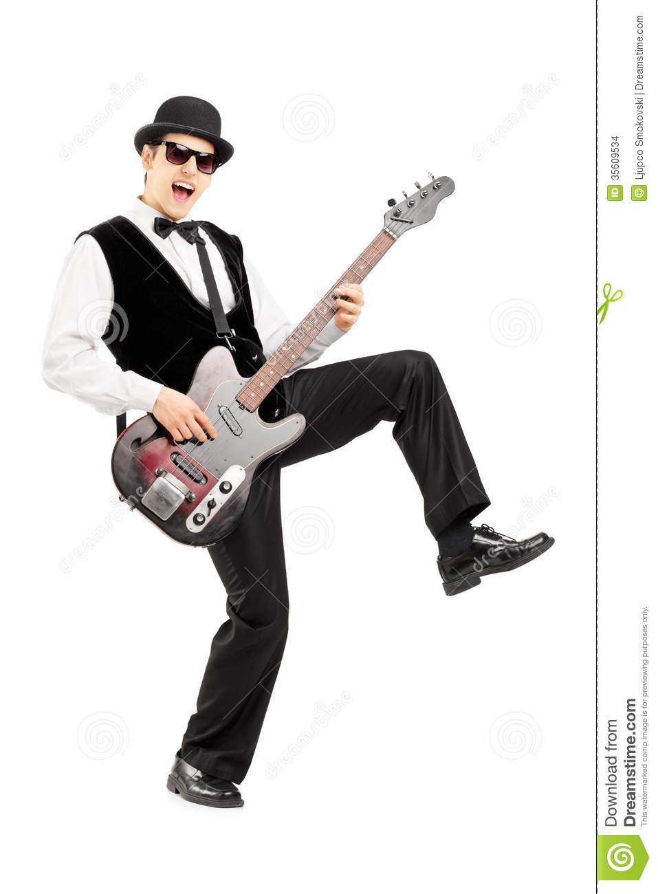 ... of an euphoric man playing a bass guitar isolated on white background