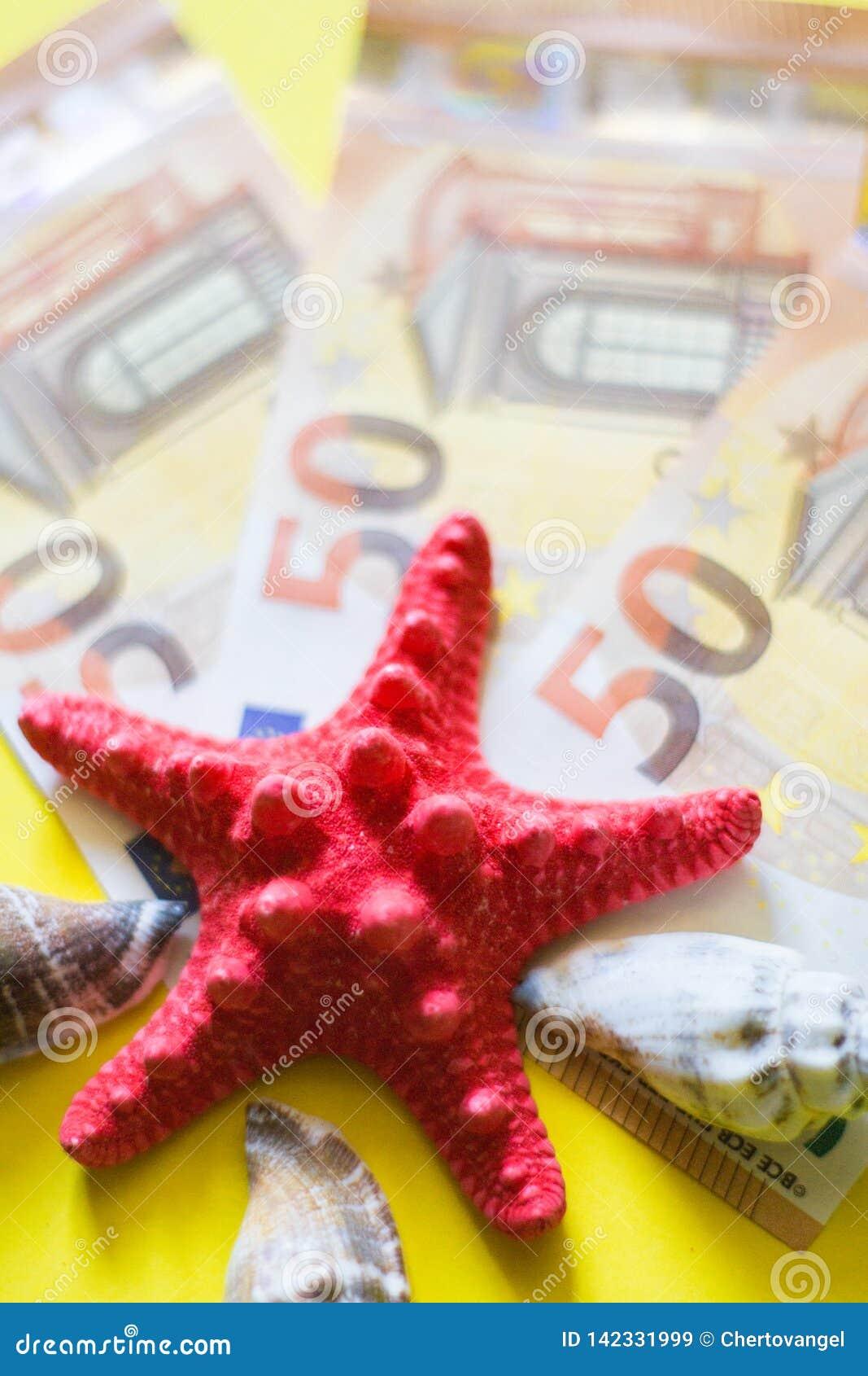 50 Euro-bancnotes mit den roten und weißen seasheels auf gelbem Hintergrund