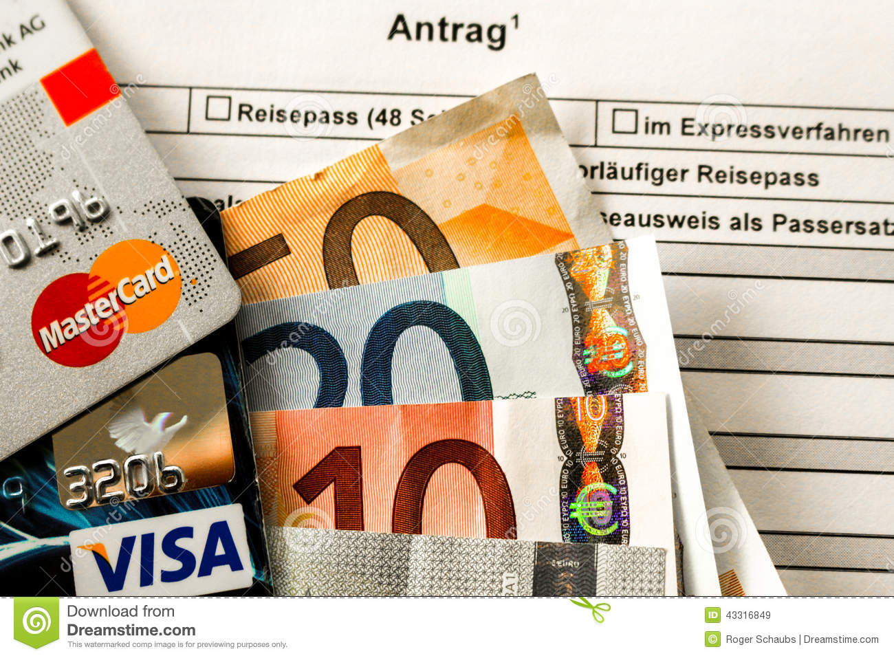 Euro Bank Notes With Mastercard And Visa Card On A German Passport