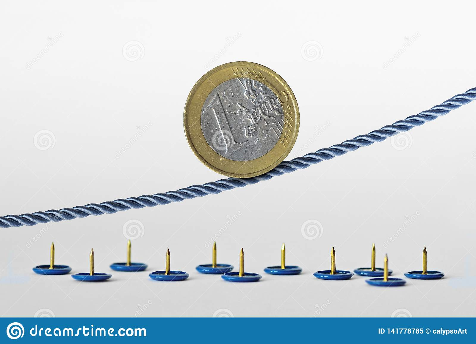 Euro coin on rope over push pins - Concept of upward trend of euro currency and euro currency risk