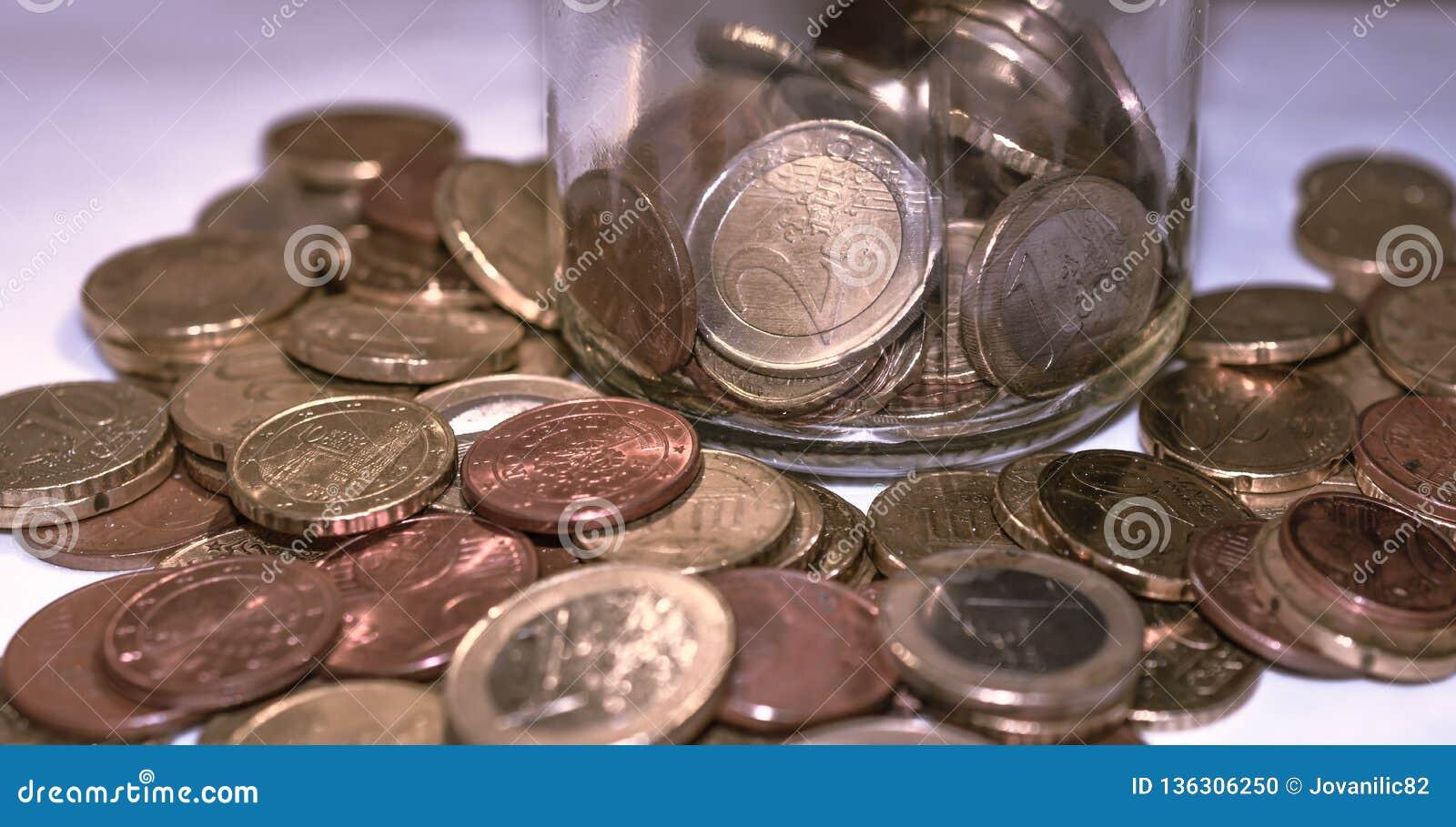 Euro Coins, piggy bank jar whit coins