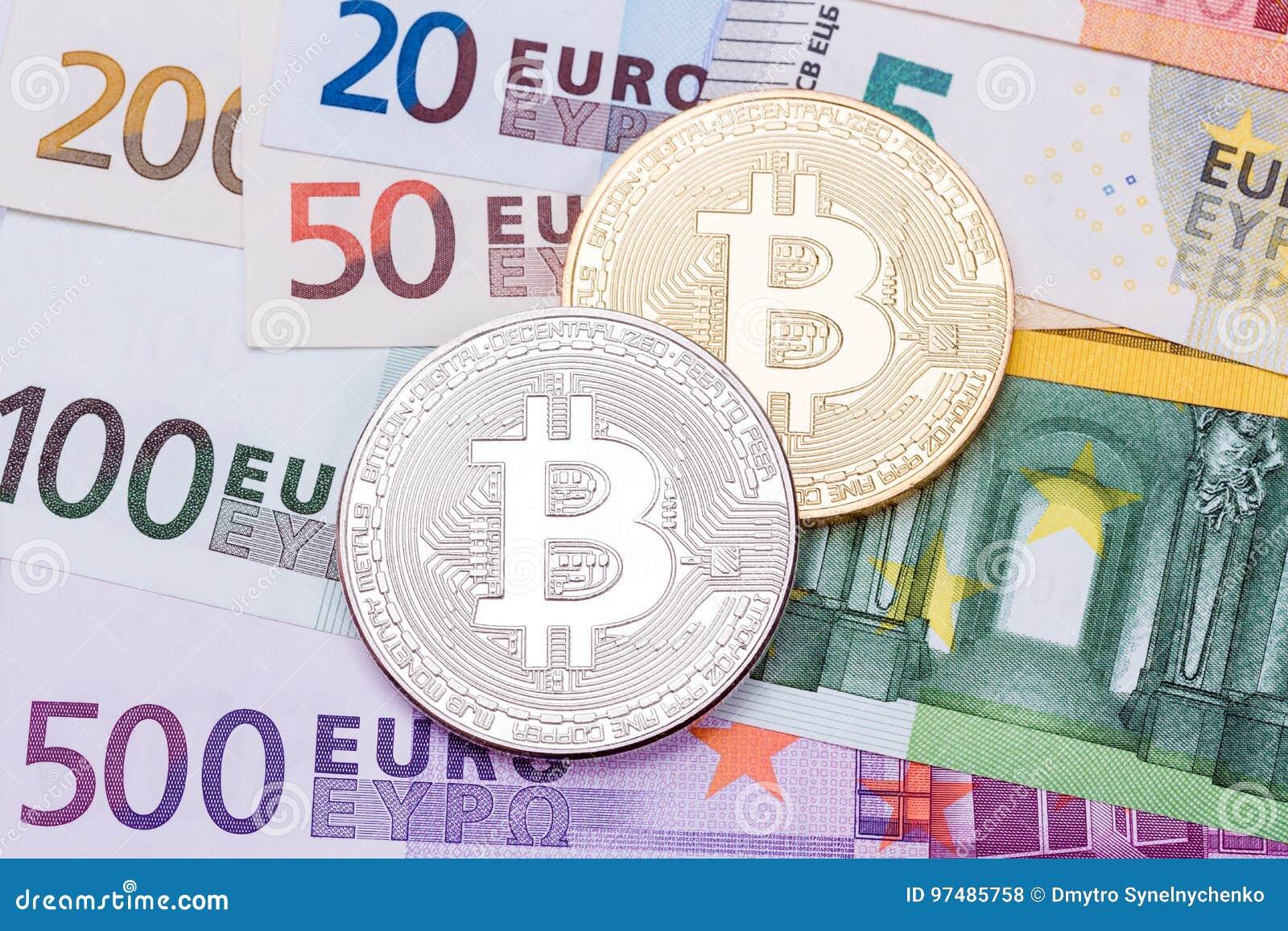 Euro e fondo del dollaro coperto di bitco dorato e d argento