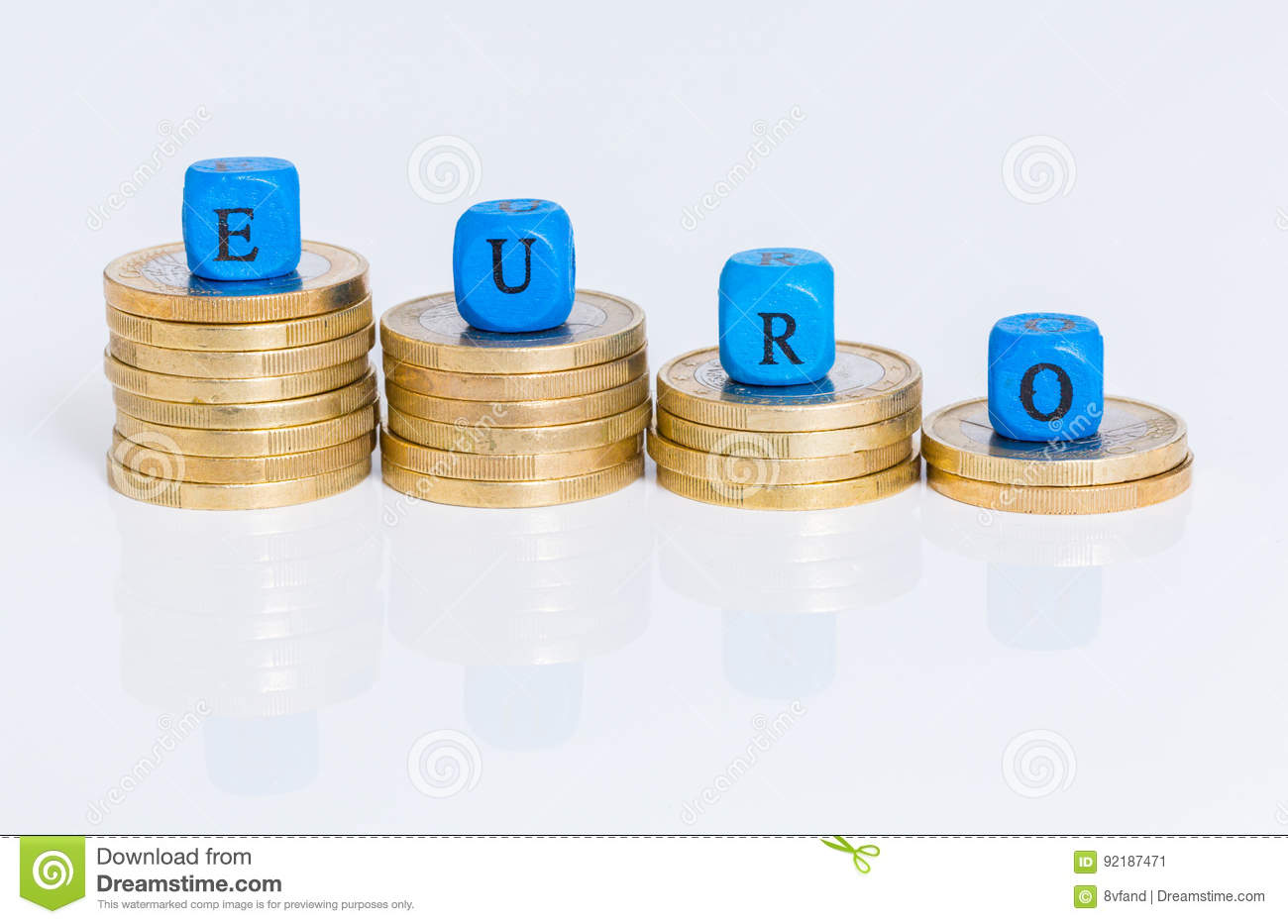 Euro letter cubes with coins against white background