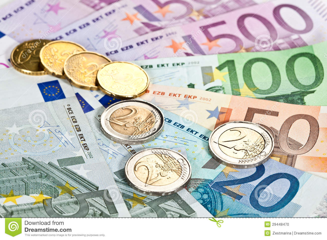 Euro money: closeup of banknotes and coins.