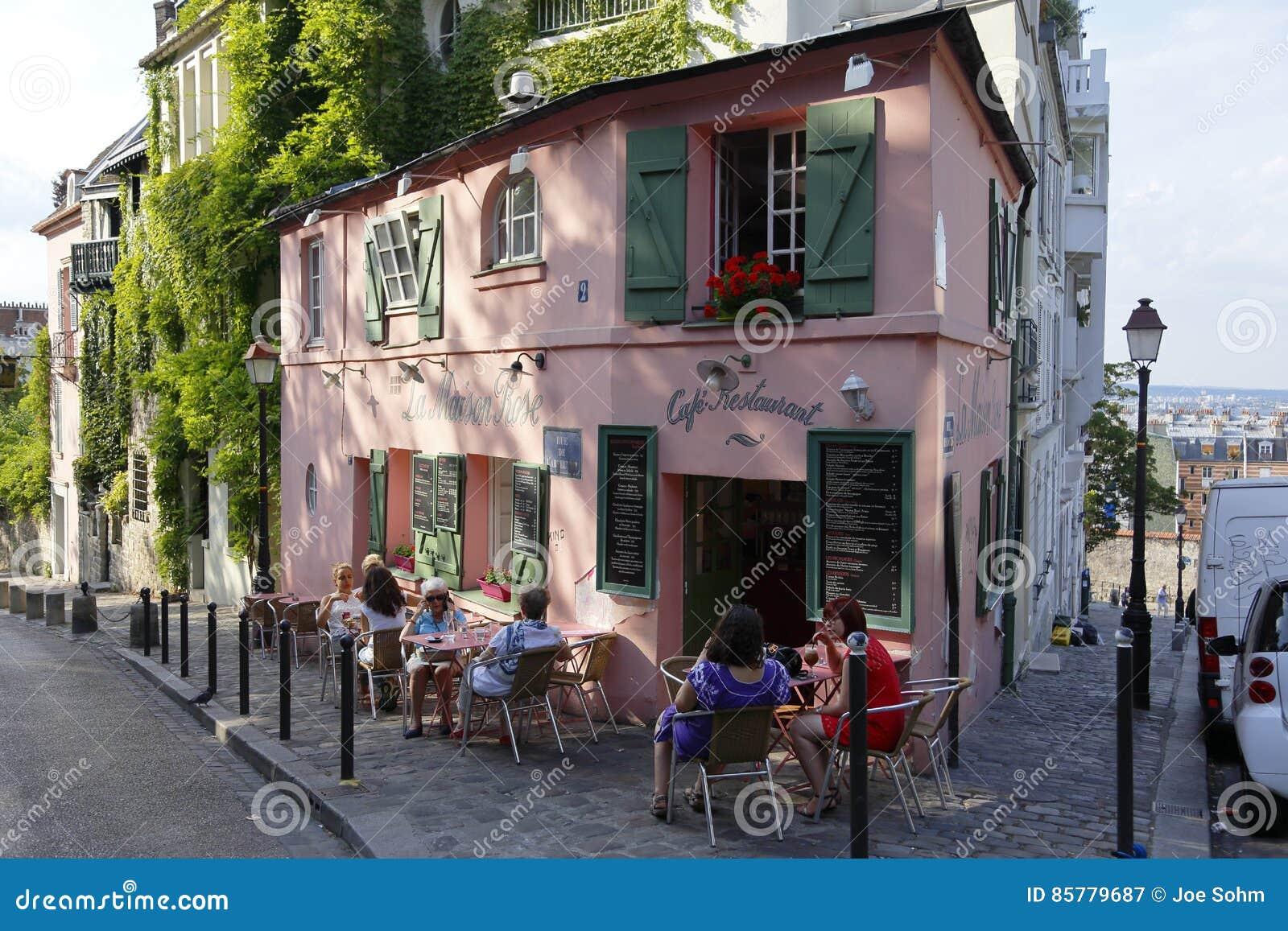 Europe france paris montmartre la maison rose french cafe rue de labreuvoir people walking on street and car parked on streetside august 2015