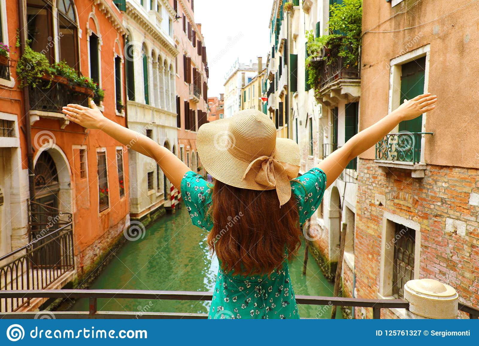 Europe travel vacation fun summer woman with arms up and hat hap