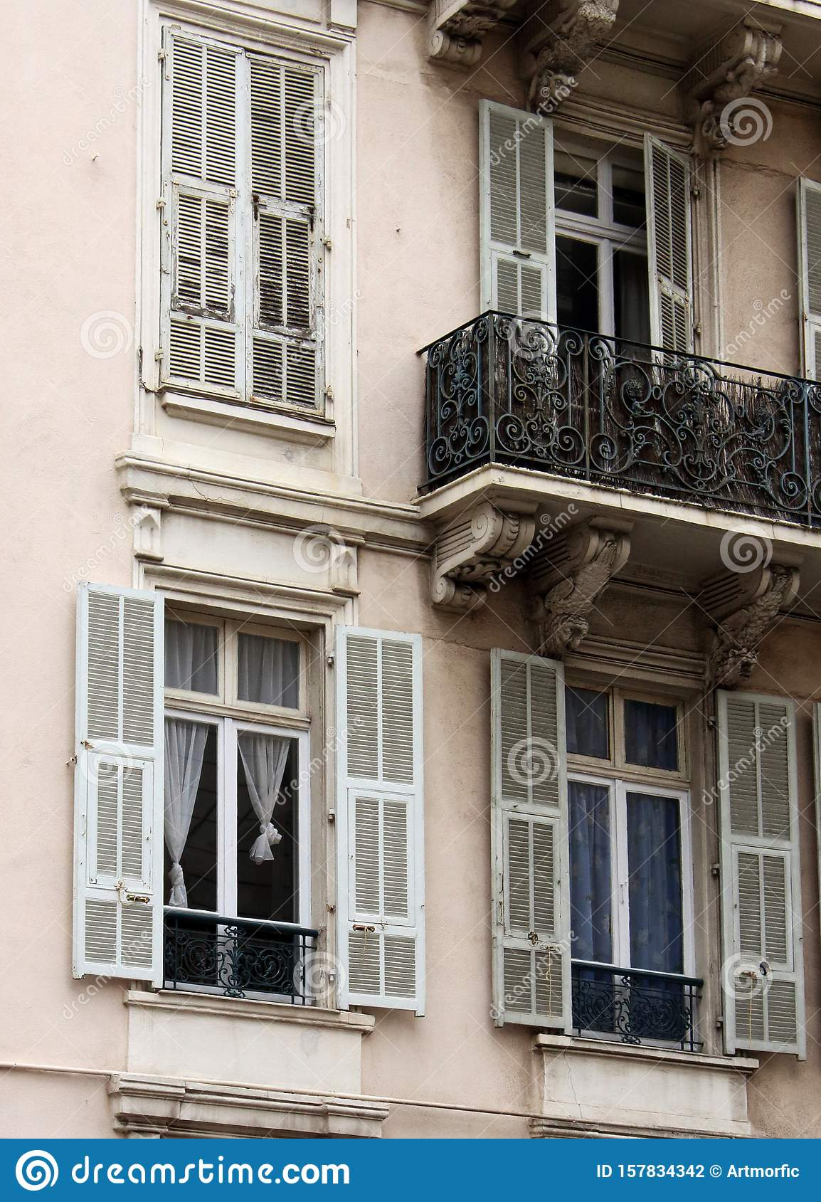 European Architectural Building With Balconies And Window ...