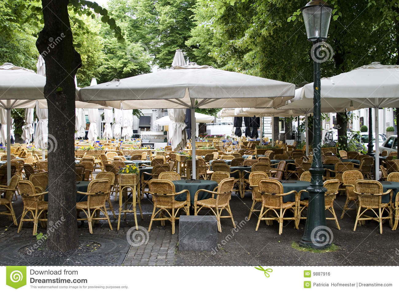 Empty chairs in outdoor cafe or restaurant on summer day stock photo